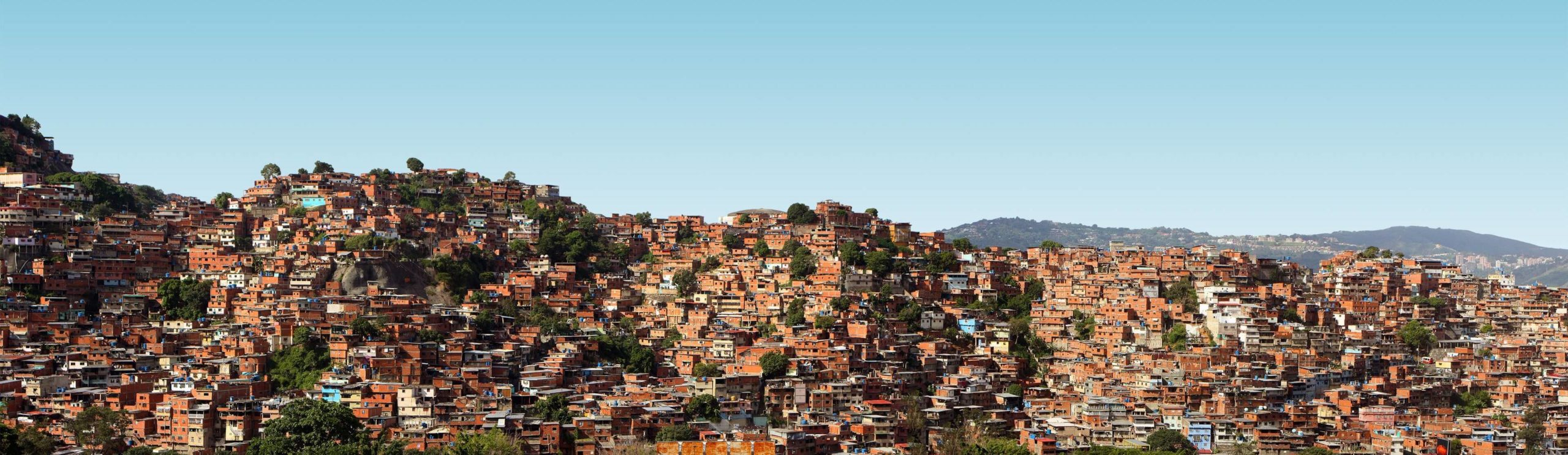 Hills covered in houses in Caracas, Venezuala. One of the most dangerous cities in the world.